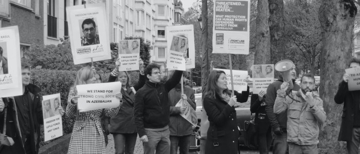 Representatives of IPHR and other human rights NGOs are holding a demonstration in Brussels in November 2014, demanding the release of Azerbaijani human rights defenders.